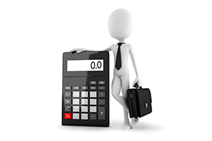 business man standing near a calculator